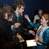 "Martin Johnson of Andover, second from left, the lead singer for the hit band Boys Like Girls, gets a hug from one of his fans, Brianna Marin, 16, of Roslindale after a screening of his band's new DVD, ""read between the lines"" at Patriot Place in Foxboro, Sunday, Nov. 2, 2008. Hundreds of of fans, mostly young girls, showed up for the screening. Fans who bought a DVD were also treated to a picture and autograph session after the showing.Ê  Photo by Mike Dean"