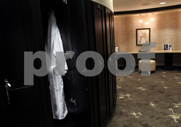 The All Saints Womens Center in North Andover has a changing room with lockers and robes. Photo by Angie Beaulieu