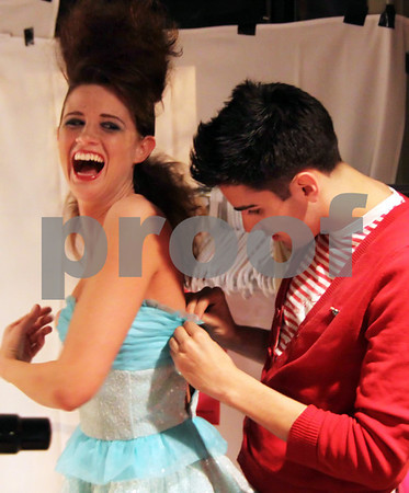 Andover: Phil Picardi of North Andover, fashion show coordinator, adjusts a party dress on model<br /> Allie Barone of Bradford,<br /> at the Ladies Night Fashion Show, featuring Betsey Johnson designer fashions, Thursday, at Glory Restaurant,<br /> Andover.<br /> 4-16-09               Photo by Frank J. Leone, Jr.