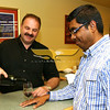 At left, Same Messina, host and proprietor of Wine Connection, pours a Barbaresco Italian wine for Mahesh Balan, Class of 2008,<br /> both are from North Andover.