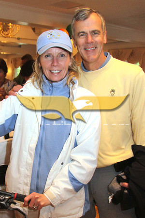 City Desk, Andover: Lisa and Steve Andrews of Andover, Pike parents, with the mountain bike auction item, at the Pike School Golf Outing Auction Block Party Fundraiser, Monday, at Indian Ridge Country Club, Andover. 5-16-11, Photo by Frank J. Leone, Jr.