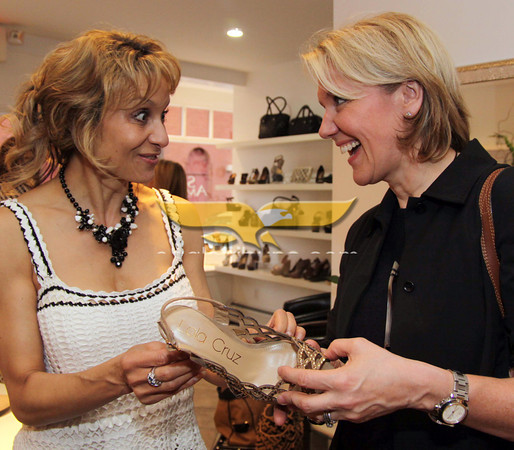City Desk, Andover:  Admiring the shoes, at left, Sylvia Sasso of Shaperella, Andover and Sally Bament, both are from North Andover,<br /> at the Grand Opening of Sole Amour store, 10 Post Office Avenue, Andover.<br /> 4-28-11,  Photo by Frank J. Leone, Jr.