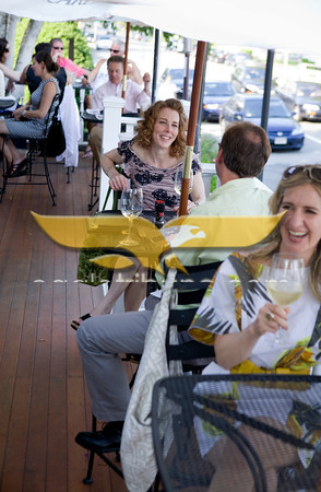 Melissa Bacskai enjoys dinner with her husband Brian on the front patio of Palmers Restaurant and Tavern.   Aricia Symes-Elmer, front, takes advantage of a warm sunny evening. <br /> Photo by Jan Lee Seeger.