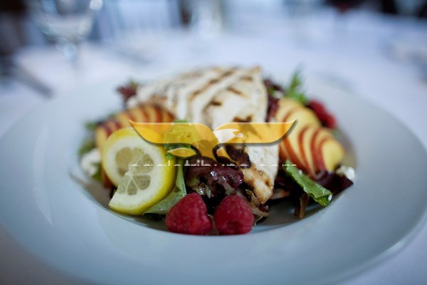 Grilled Chicken and Peach Salad with raspberry dressing and goat cheese at Palmers Restaurant and Pub.<br /> Photo by Jan Lee Seeger.