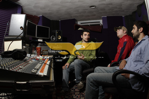 MARY SCHWALM/Staff photo.  Leaders Led band members Guy Bardascino, Tyler Mortenson, and Alex Bardascino talk about their track mix at Phenominal Audio, a recording studio in Lawrence.  6/23/11