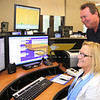 City Desk, North Andover: Sandy and Brig Leland of North Andover at the new Communications Center, <br /> at the Open House, Saturday, at new North Andover Police Station, Osgood Street, North Andover, <br /> 5-14-11, Photo by Frank J. Leone, Jr.