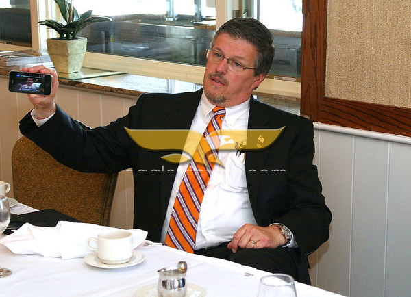 Photo by Frank J. Leone, Jr. June 10, 2010:  Andover Service Club Breakfast Meeting with Al Getler at Andover Country Club, Andover. Guest speaker, Al Getler, publisher of the North of Boston Media Group which includes The Eagle Tribune Newspapers and the ANDOVERS Magazine, demonstrates the I-Phone video breaking news, that is gathered locally, by The Eagle Tribune and available to subsrcribers.