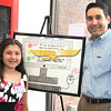 """City Desk, North Andover: Liana Spino, 9, Kittridge School 4th grade, with her winning poster entry, """"Internet Safety Tips"""", with her dad, John Spino, both are from North Andover, at the Open House, Saturday, at new North Andover Police Station, Osgood Street, North Andover, 5-14-11, Photo by Frank J. Leone, Jr."""