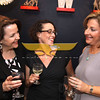 City Desk, Andover:  Seen at the opening, from left, Michelle Corey of North Andover, Carina & Company, Andover, Jennifer Johnson, of North Carolina, sister of co-owner, and Michelle Jacobson of Andover, sales consultant, toasting the new store, at the Grand Opening of Sole Amour store, 10 Post Office Avenue, Andover. 4-28-11,  Photo by Frank J. Leone, Jr.