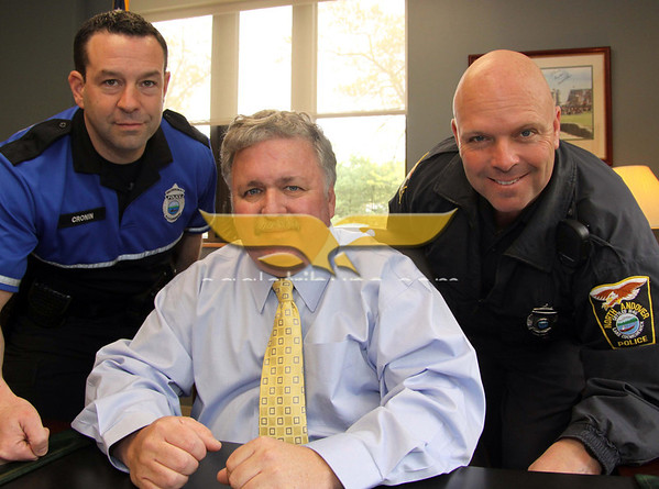 City Desk, North Andover: Event organizers, at left, Detective Dan Cronin, Chief Richard Stanley and Officer Bob Hillner, all are from North Andover. Chief Stanley is leaving the department in May, after many years of service, at the Open House, Saturday, at new North Andover Police Station, Osgood Street, North Andover, 5-14-11, Photo by Frank J. Leone, Jr.