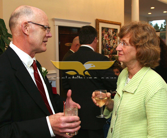 City Desk, Haverhill: James Callahan of Phizer, Andover and Kay Berthold Frishman, also of Andover, executive director at Family <br /> Service, Inc., catch up, at the Merrimack Valley Chamber of Commerce 2011 Annual Dinner and Awards, Wednesday, DiBurro's Function Hall, Haverhill. 5-4-11, Photo by Frank J. Leone, Jr.