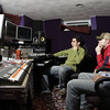 MARY SCHWALM/Staff photo.  Leaders Led band members Guy Bardascino, Tyler Mortenson, and Alex Bardascino listen to their track mix at Phenominal Audio, a recording studio in Lawrence.  6/23/11