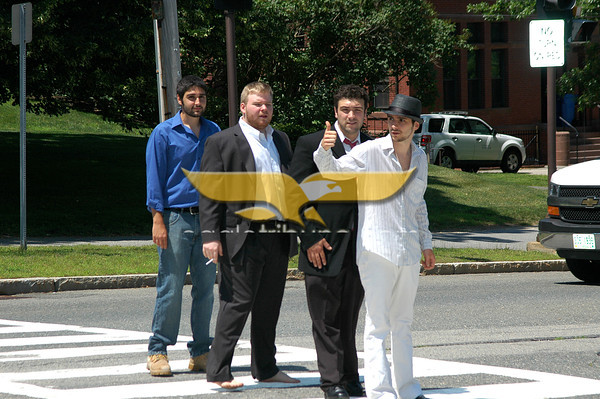 Members of Leaders Led, from front to back, Guy Jerry, Justin Trulli, Tyler Mortenson, and Alex Bardascino prepare to cross Main St. in Andover. Photo by Brianna Healy