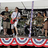 MARY SCHWALM/Staff photo.  Leaders Led from left: Tyler Mortenson, Guy Bardascino, drummer Justin Trulli, and Alex Bardascino perform on the North Andover town common.  7/3/11