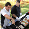 From left, firefighters Rob Hardacre and Graham Rowe, both of North Andover, and the North Andover Firefighters Relief  Association cooked up Italian sausages to raise funds for their organization at the Happy Birthday America 4th of July Celebration on July 1, 2011 at North Andover Common. Photos by Frank J. Leone, Jr.