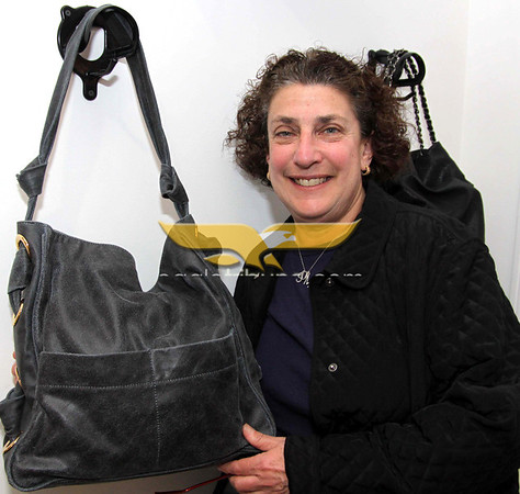 City Desk, Andover:  Mimi Queen of Andover and Sweet Mimi of Andover with a designer handbag, she formerly occupied the current space, at the Grand Opening of Sole Amour store, 10 Post Office Avenue, Andover. 4-28-11,  Photo by Frank J. Leone, Jr.