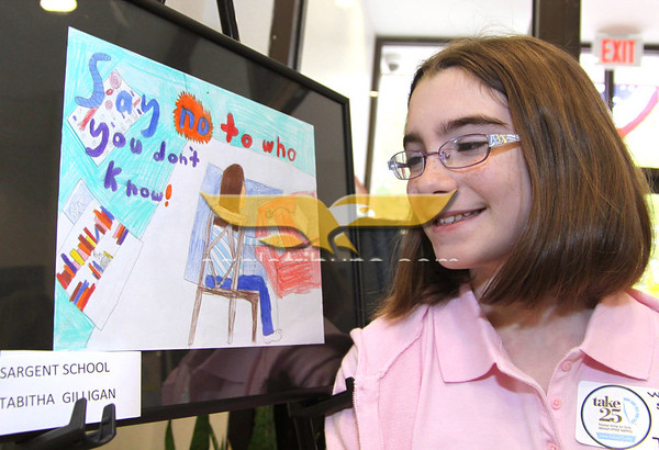 """City Desk, North Andover: Tabitha Gilligan, 11, of North Andover, Sargent School 5th grade with her winning poster entry, """"Say No to Who You Don't Know"""", at the Open House, Saturday, at new North Andover Police Station, Osgood Street, North Andover, 5-14-11, Photo by Frank J. Leone, Jr."""