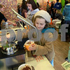 JAN SEEGER/Staff photo. <br /> Natalie Guterman, 8, of Andover serves herself toppings on a bowl of frozen yogurt at Orange Leaf in Andover.