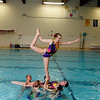 The Ana Synchers senior team performs a lift with Alison Ziel, 18, of North Andover.<br /> Photo by Mary Schwalm.