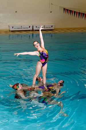 The Ana Synchers senior team perform a lift with Alison Ziel, 18, of North Andover.<br /> Photo by Mary Schwalm.