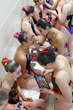 The ANA Synchers teammates help one another put put on their make-up. To keep the eye shadow from coming off the secret is to put Chapstick on first and gelatin is used to keep their hair shiny and in place.<br /> Photo by Mary Schwalm.