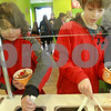 JAN SEEGER/Staff photo. <br /> Brendan Feyl, 8, of Andover, left, and Matthew Onofrio, 10, of North Andover, serve up cups of frozen yogurt at Orange Leaf in Andover.