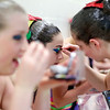 Ali Ziel, 18, left, puts her make-up on while Evan Costanzo, 13, helps Caitlin Klauer, 12, with hers. The ANA Synchers is the largest team in the country with 87 swimmers.<br /> Photo by Mary Schwalm.