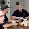 "MARY SCHWALM/Staff photo Andover firefighters eat ""Firehouse Meatloaf""  5/28/13"