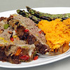 "MARY SCHWALM/Staff photo ""Firehouse Meatloaf"" with sweat potatoes and grilled asparagus. 5/28/13"