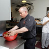 "MARY SCHWALM/Staff photo  Firefighter Bob Murphy mixes up a batch of ""Firehouse Meatloaf"" 5/28/13"