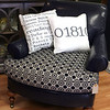 AMY SWEENEY/Staff photo. Handmade Zip Code pillows by Paula Bakies, owner of Acorn Design Center in Andover, sell for $49.<br /> Sept. 25, 2015.