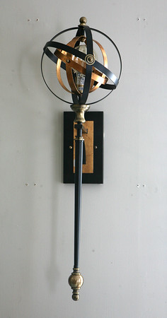 AMY SWEENEY/Staff photo.  An Orb Sconce $259.<br />  Paula Bakies, owner of Acorn Design Center in Andover.Sept. 25, 2015.