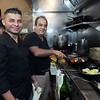 CARL RUSSO Staff photo. Owner and executive chef, Faisal Bazarto, right,  and his chef, Will Flores work in the kitchen of Buono Bistro.