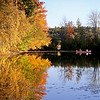 MARY SCHWALM/Staff photo Boaters fish on a fall day on a pond adjacent to Fosters pond in Andover. 10/12/14