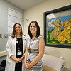 PAUL BILODEAU/Staff photo. Doctor Caitlin Neri, left, and Psychologist Laura Goldstein, both Andover natives, at the Pain Clinic at the Boston Medical Center in Boston.