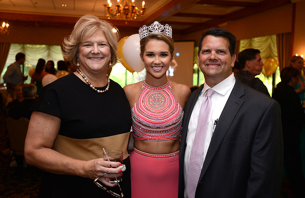 RYAN HUTTON/ Staff photo<br /> Miss MassachusettsTeen USA 2015 Sophie Baird with her parents Jan and Scott at her send-off party and fundraiser for the Lazarus House at the Andover Country Club before she went to the Bahamas to compete in the national competition.