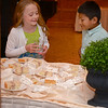 RYAN HUTTON/ Staff photo<br /> Reid Giribaldi, 8, left, and Greyson Baird, 9, eye the cake at the send-off party for Greyson's sister Miss MassachusettsTeen USA 2015 Sophie Baird at the Andover Country Club.