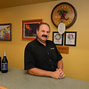 RYAN HUTTON/ Staff photo<br /> Wine Connection owner Sam Messina at the tasting bar in the North Andover establishment.