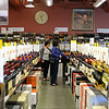 RYAN HUTTON/ Staff photo<br /> Shoppers browse the aisles of Wine Connextion in North Andover.