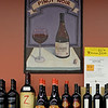 RYAN HUTTON/ Staff photo<br /> Paintings of different types of wine line the walls at Wine Connextion in North Andover.