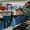 RYAN HUTTON/ Staff photo<br /> Barber David Perez cuts a customer's hair at the Andover Barber Shop.