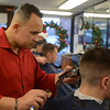 RYAN HUTTON/ Staff photo<br /> Barber Alex Ramirez cuts the hair of customer Sam Vecchi at the Andover Barber Shop on Main Street.