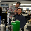 RYAN HUTTON/ Staff photo<br /> Barber Roger Desharnais trims tieback of customer Richard Maher's neck at the Andover Barber Shop.