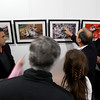 "MARY SCHWALM/Staff photo Professional photographer Damian Strohmeyer talks to a group gathered around one of his many iconic photographs at the opening of his show ""A Lifetime of Sports Photography"" at the Theia Studios in North Andover.  3/15/15"