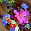 RYAN HUTTON/ Staff photo<br /> A bouquet from aster b. flowers sits at the Andover Farmer's Market.