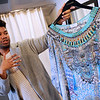 TIM JEAN/Staff photo  <br /> Luis Nunez talks about the colorful silk dress designed by Camilla.   3/15/16