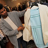 TIM JEAN/Staff photo  <br /> Luis Nunez talks about a dress designed by Raoul in Sea Breeze Evergreen parred with a jacket/coat from designer Pomandere.     3/15/16
