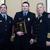 CARL RUSSO/Staff photo. STEPPING OUT: Andover firefighters/EMTs from left, Jameson Lockhart and David Eulie are congratulated by Andover Fire Chief, Michael Mansfield after they received the Exchange Club of Lawrence, Firefighters of the Year awards for saving a man's life during the Annual Feaster Five road race on Thanksgiving Day. This is the Exchange Club's 54th. annual Public Safety Award ceremony which is sponsored by Wheelabrator of North Andover. 1/21/2016.