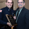 CARL RUSSO/Staff photo. STEPPING OUT: Andover detective, Kevin Aufiero is congratulated by his father, Richard after receiving the Exchange Club of Lawrence, Police Officer of the Year award along with detective Peter Reming for investigating and solving a house break involving a 16 year old victim who was home at the time. The perpetrator was eventually caught.  This is the Exchange Club's 54th. annual Public Safety Award ceremony which is sponsored by Wheelabrator of North Andover. 1/21/2016.