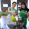 CARL RUSSO Staff photo. Chef Anne Tran talks to Tessa Barcelo, left 12 of Andover, Lily Seville, right 11 of North Andover as Eva McKone, 12 of Andover mixes the dough for the red velvet whoopee pies. The students are learning to bake at the Taste Buds Kitchen cooking school for kids in North Andover. 3/09/2016